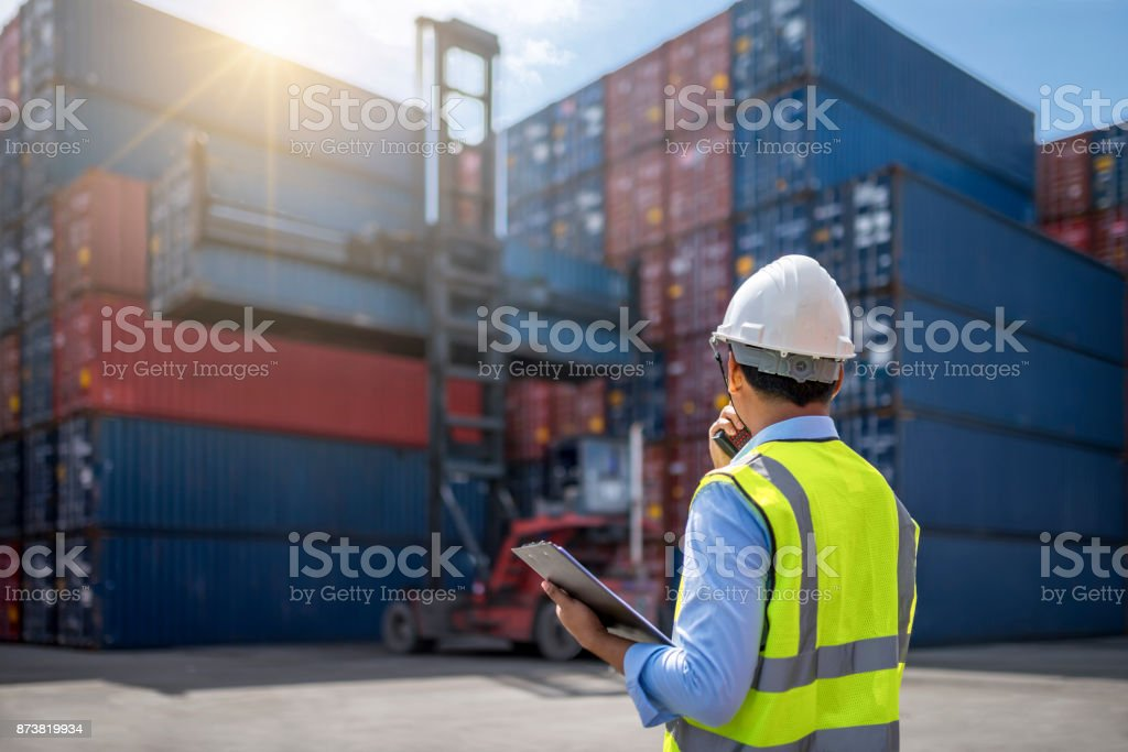 Foreman control loading Containers box stock photo