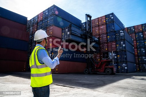 istock Foreman control loading Containers box to truck for Logistic Import Export Background, Business logistic concept, import and export concept