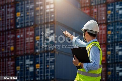 istock Foreman control loading Containers box to truck for Logistic 1130216892