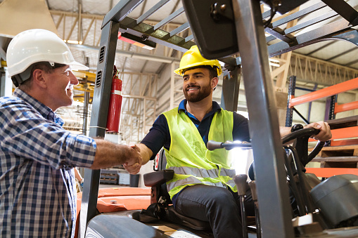 Foreman Shaking Hand With Worker On Forklift Stock Photo - Download Image Now