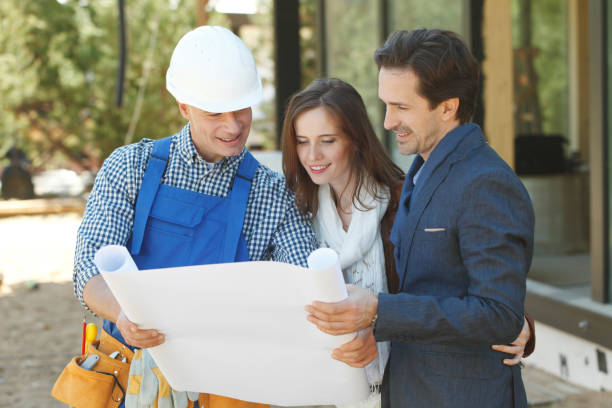 Foreman shows house design plans stock photo