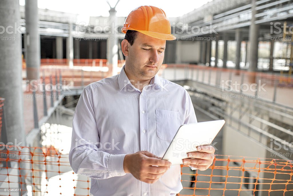 Foreman supervising project at the construction. stock photo