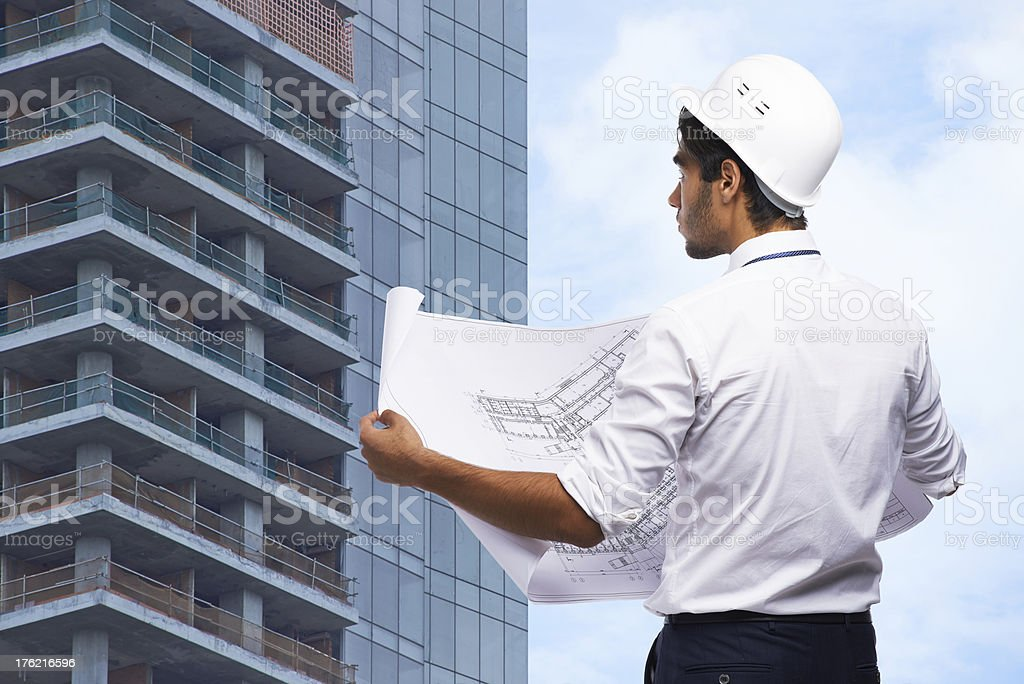 Foreman with blueprint royalty-free stock photo
