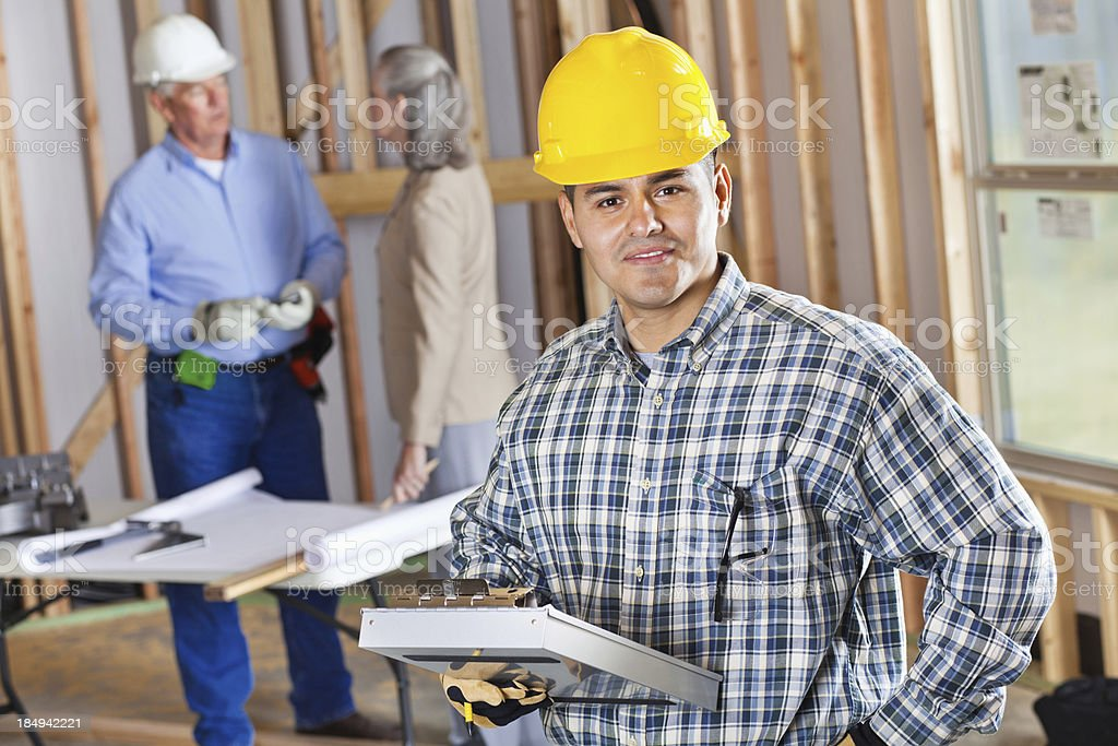 Foreman with clipboard at construction site royalty-free stock photo