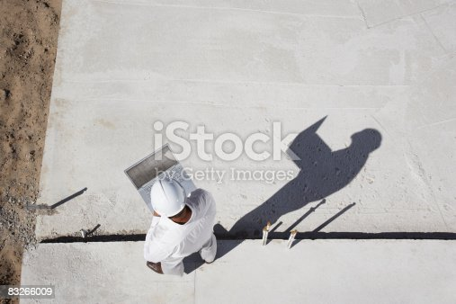 istock Foreman with laptop at new construction site 83266009