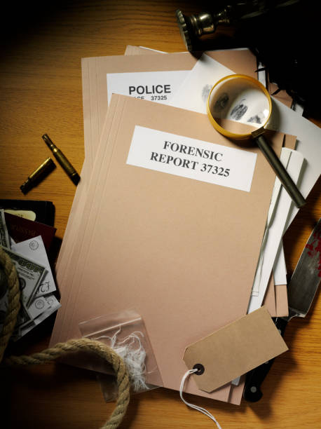 forensic and police paperwork with evidence from a crime - murder mystery stock photos and pictures