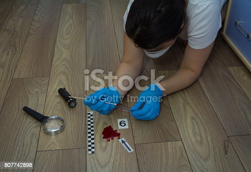 istock A forensic expert takes a blood sample on a sterile stick 807742898