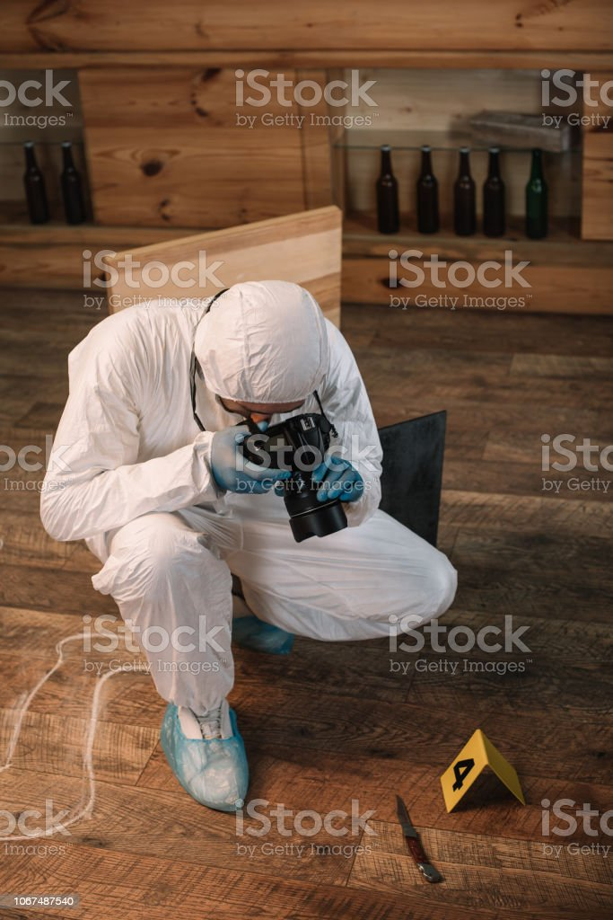 Forensic Investigator Documenting Evidence With Camera At Crime Scene Stock Photo Download Image Now Istock