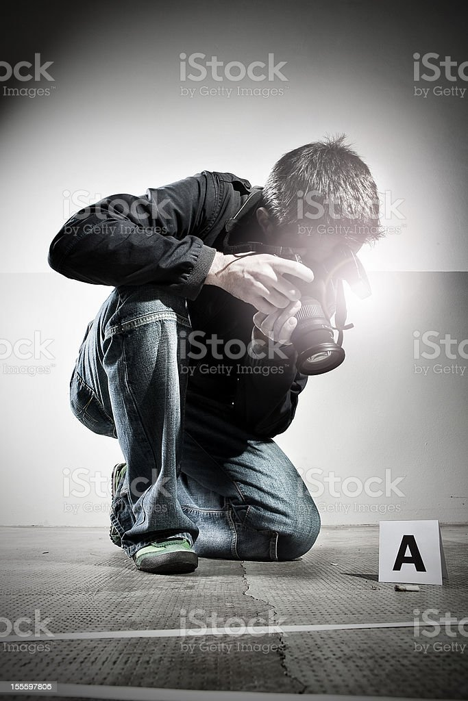 Forensic Photographer at Crime Scene royalty-free stock photo