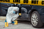 Forensic scientist at work. Crime scene.