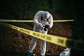 Forensics on murder crime scene photographing evidence