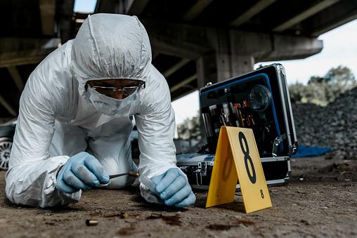 Senior forensic scientist working at crime scene