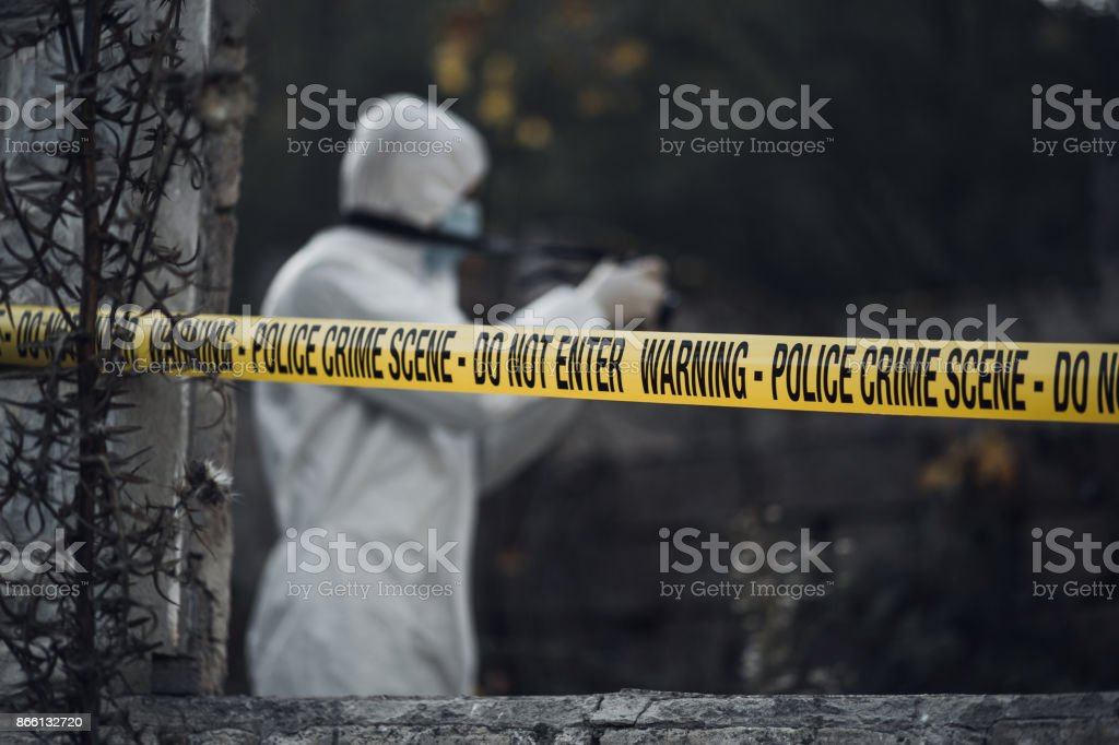 Forensic scientist photographing a building interior stock photo