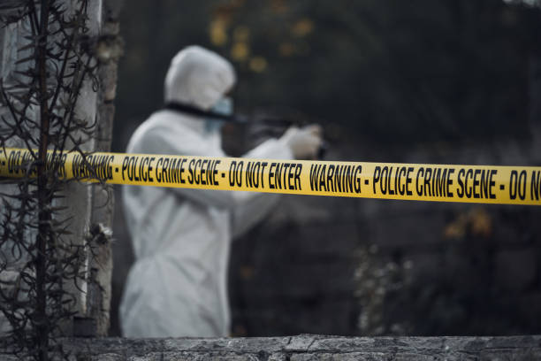 forensic scientist photographing a building interior - white suit stock photos and pictures
