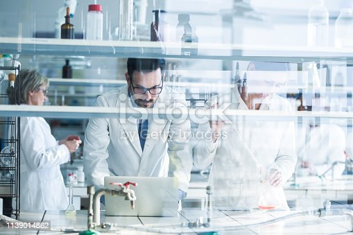 499203366 istock photo Forensic scientist working on new research in laboratory. 1139014862