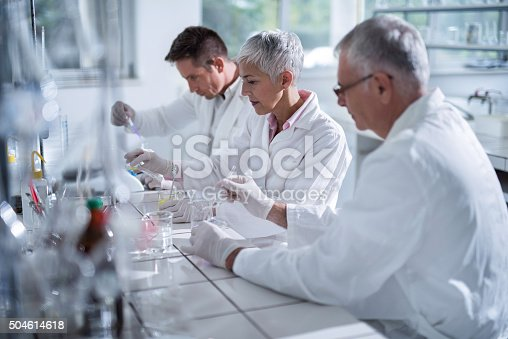 499203366istockphoto Forensic scientists working in team on a new research. 504614618