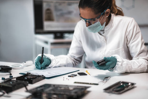 Forensics. Police Expert Examining Confiscated Mobile phone stock photo