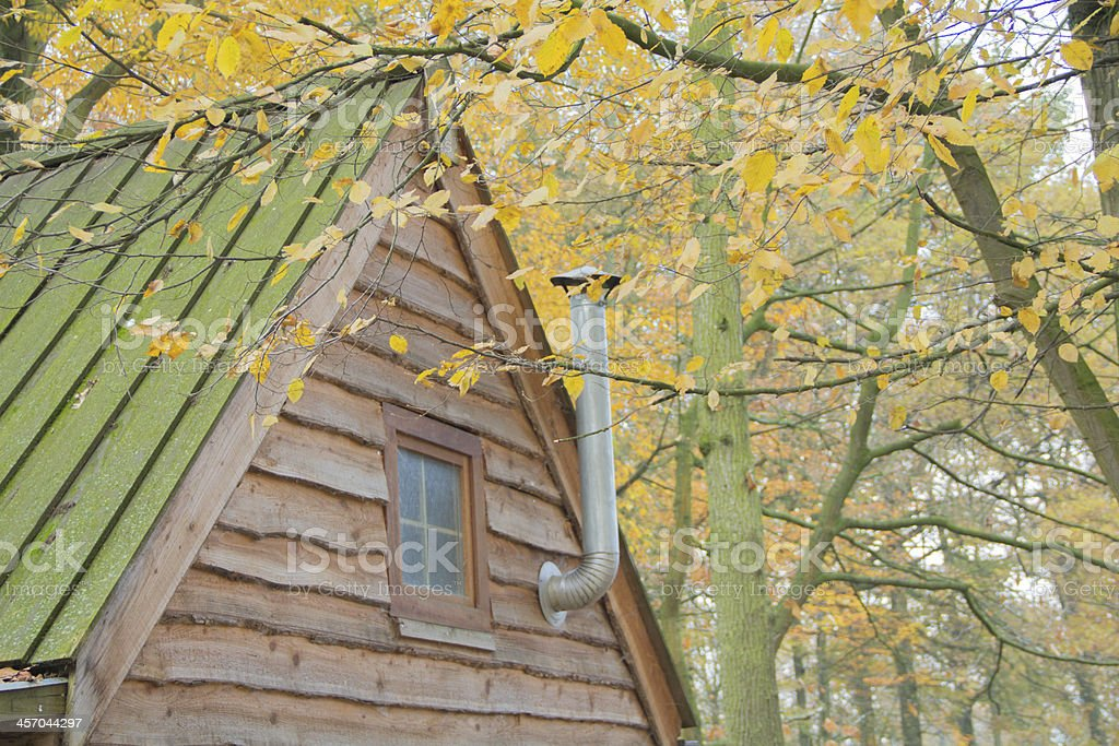 forest cabin with chimney royalty-free stock photo
