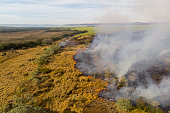 Drone view of burning pasture in Brazil on dry season