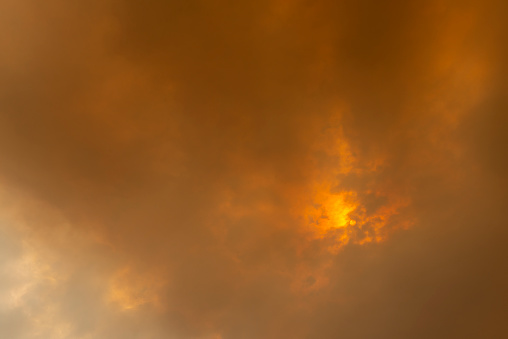 Sun peering thru fire smoke