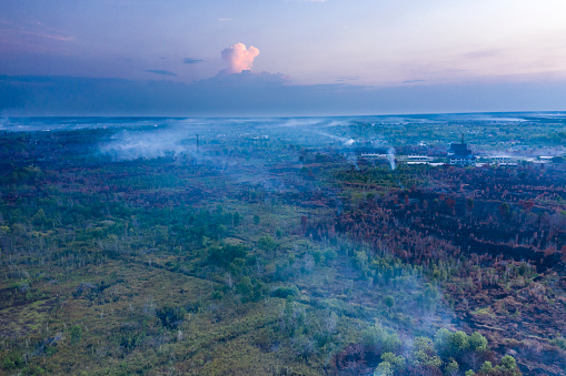 Aerial drone view of important forest fires caused by the slash and burn techniques in the island of Borneo (commonly named Kalimantan) in Indonesia. Deforestation occurs on a daily basis and the natural habitats are usually replaced by palm oil plantations.