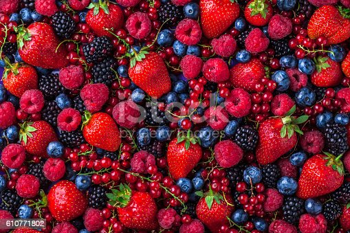 841659594 istock photo Forest fruit berries overhead assorted mix in studio 610771802