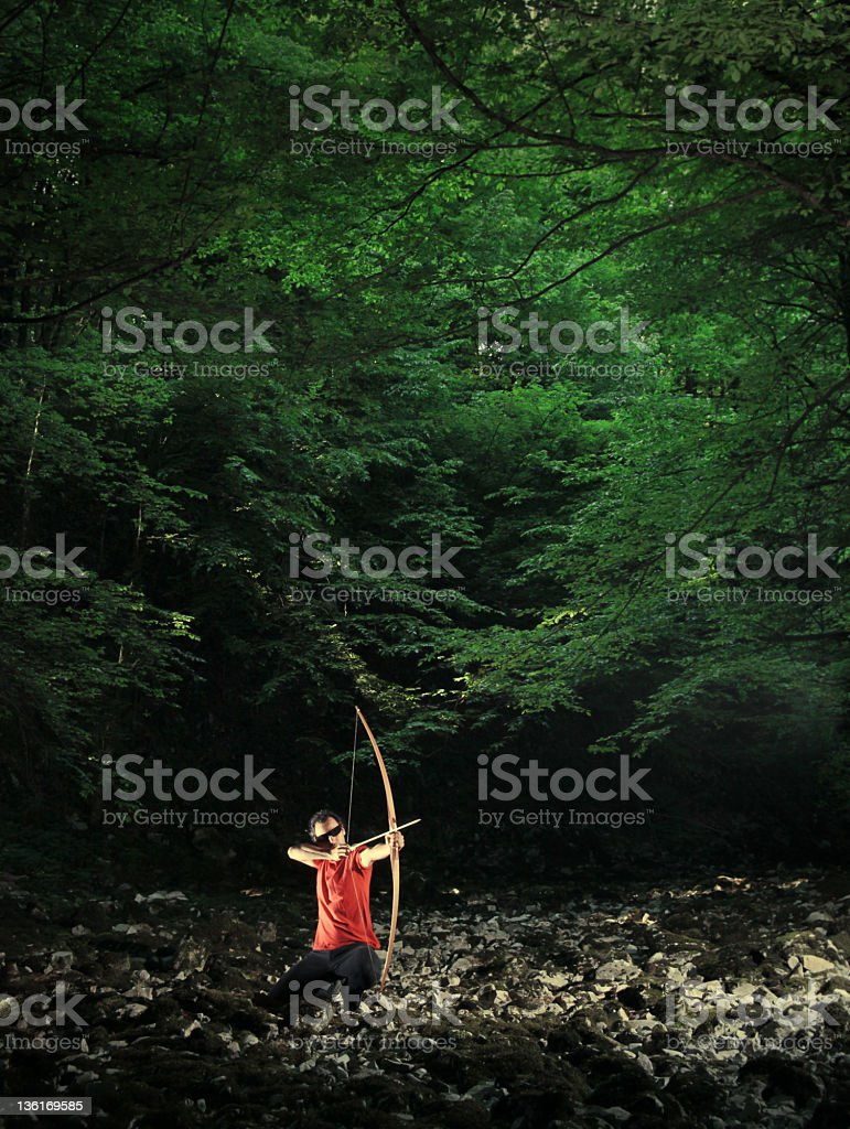 Forest longbow shooting stock photo