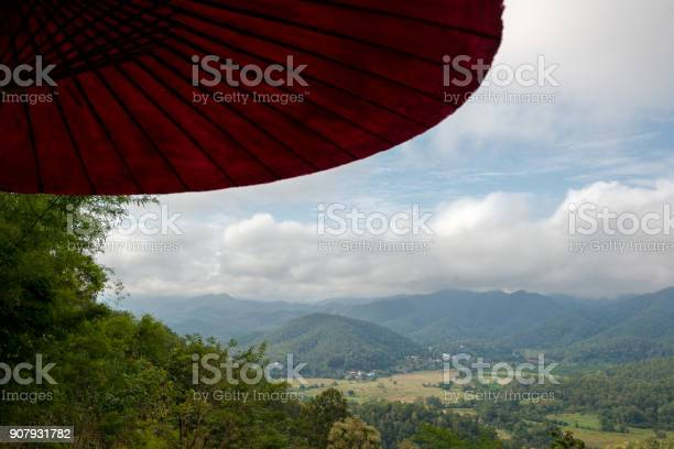 Photo of Forest Mountain aerial view from under umbrella in the terrace of countryside
