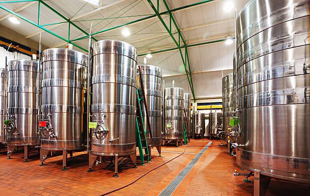 forest of fermentation tanks auf modernen weinkellerei - keller organisieren stock-fotos und bilder