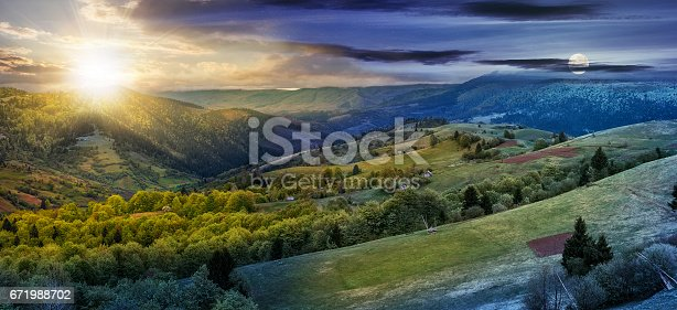 1074120624 istock photo forest on a mountain hillside in rural area. day and night change 671988702