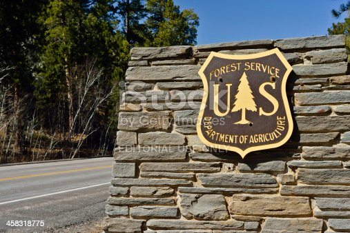 Keystone, South Dakota, USA - April 2, 2013: The emblem of the US Forest Service, part of the Department of Agriculture outside of Keystone, South Dakota.