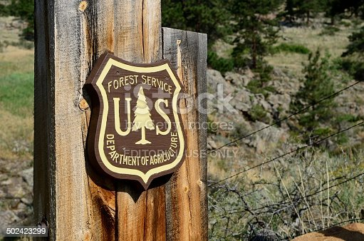 Lyons, Colorado, USA - July 24, 2013: The emblem of the US Forest Service, part of the Department of Agriculture outside of Lyons, Colorado.