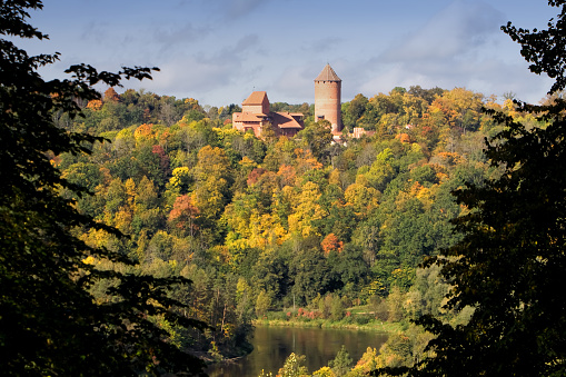 Forest view of Turaida Castle and a lake in Latvia