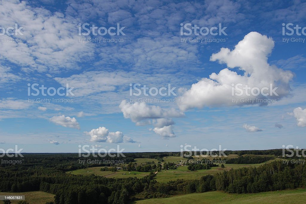 Forests and fields under sky Forests and fields under blue sky and clouds Agricultural Field Stock Photo