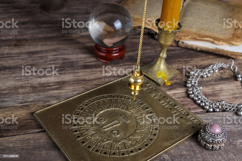 Foretelling the future with pendulum stock photo