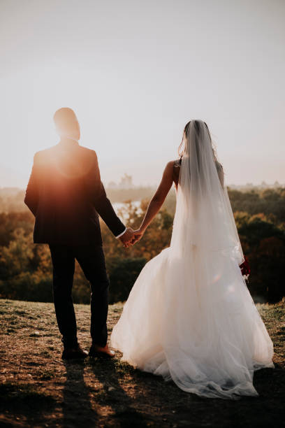 Forewer love,forewer young,forewer happy The bride and groom on their most important day in your life. They love each other, holding hands, kissing. It is the wedding dress and he in formal suits. They are ready to say to each other YES. bridegroom stock pictures, royalty-free photos & images