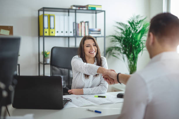 Forewoman interviewing a job candidate Young successful forewoman interviewing a job candidate at her office foreman stock pictures, royalty-free photos & images