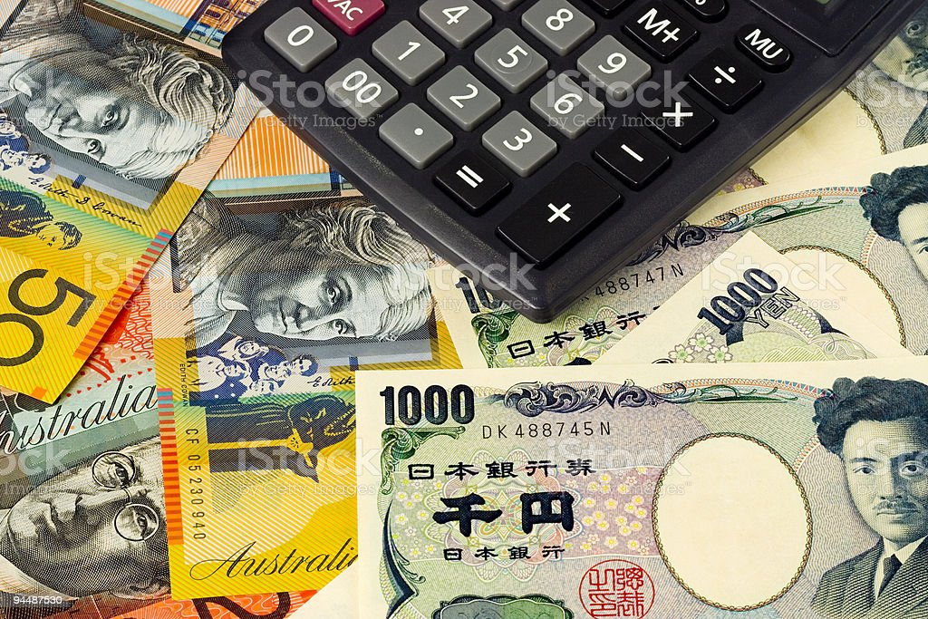 Forex - Australia and Japanese currency pair with calculator royalty-free stock photo