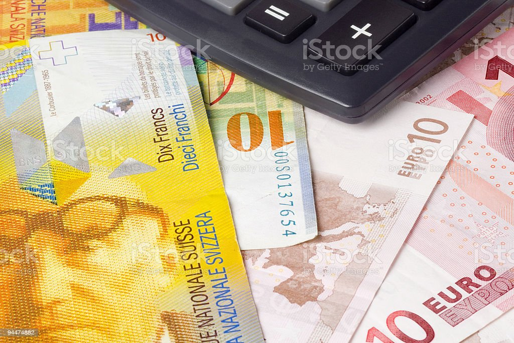 Forex - Euro and Swiss currency pair with calculator stock photo