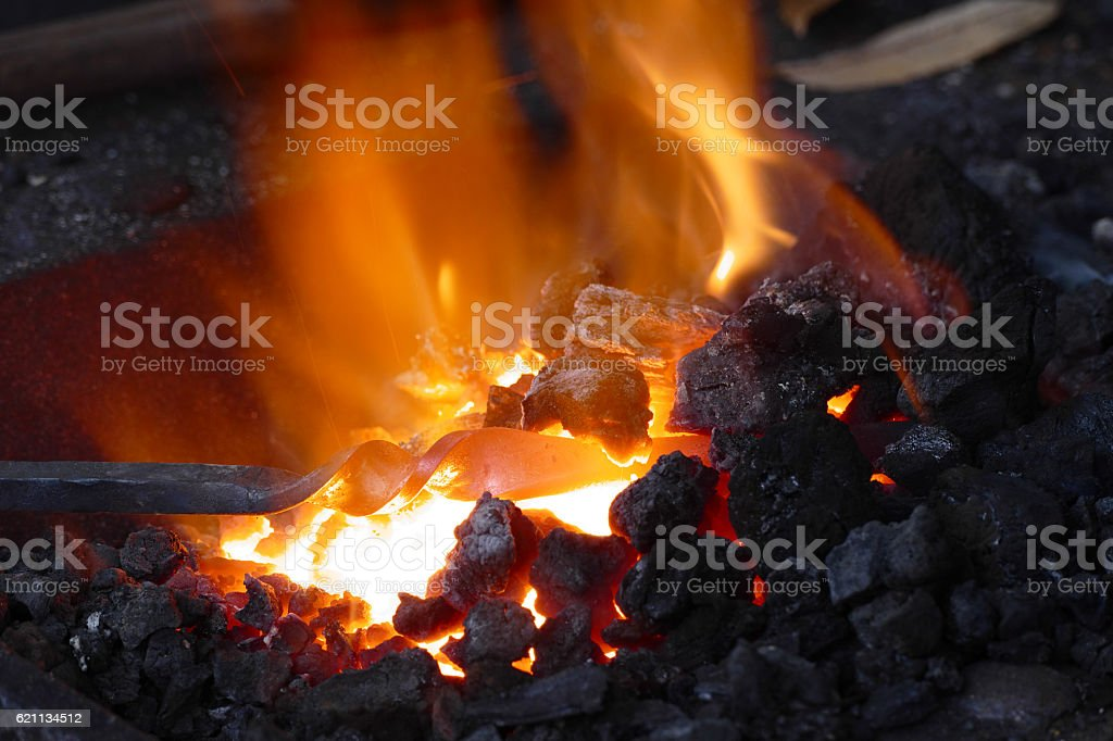 Forge with iron stick stock photo