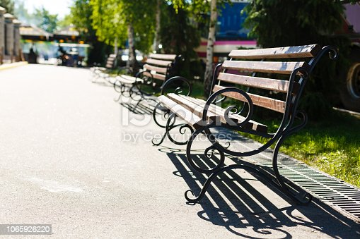 istock Forged bench in the city park 1065926220