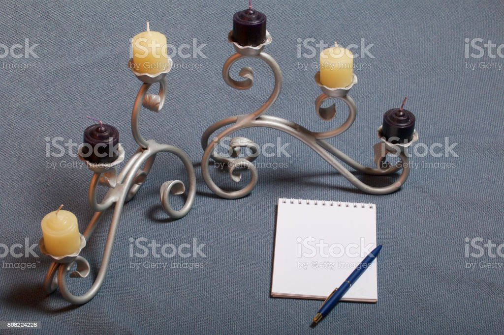 Forged Metal Candlestick With Candles There Is An Open Notepad And A Pen Stock Photo Download Image Now Istock