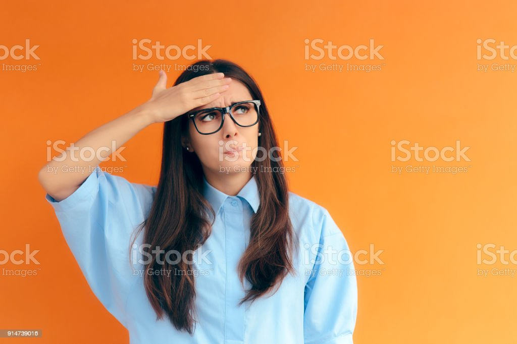 Forgetful Brainy Girl Trying to Remember Her Clever Idea stock photo