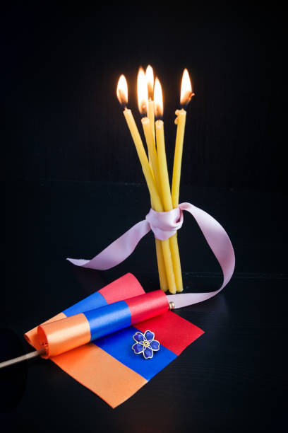 Forget-me-not- symbol of centennial of Armenian Genocide in Ottoman Empire- and flag of Armenia, burning candles. Day of Remembrance of Victims of announced on April 24 Forget-me-not- symbol of centennial of Armenian Genocide in Ottoman Empire- and flag of Armenia, burning candles. Day of Remembrance of Victims of announced on April 24 armenian genocide stock pictures, royalty-free photos & images