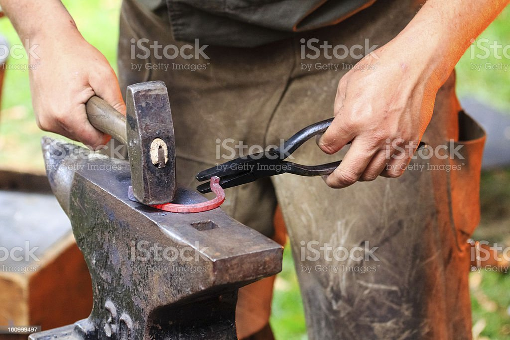 Forging a horse shoe royalty-free stock photo
