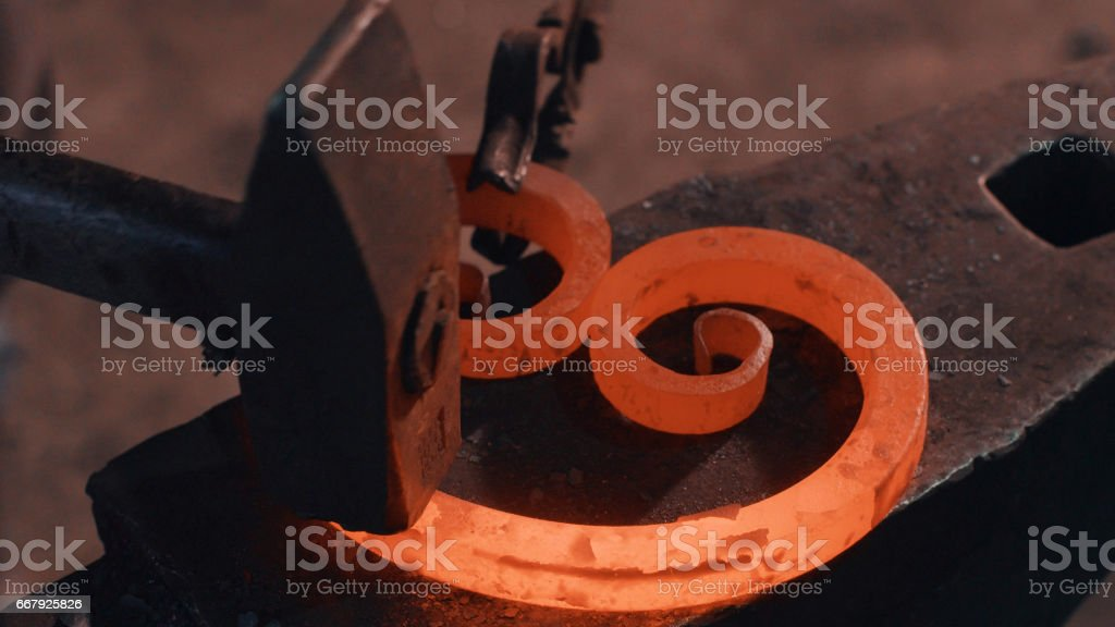 Forging of metal detail stock photo