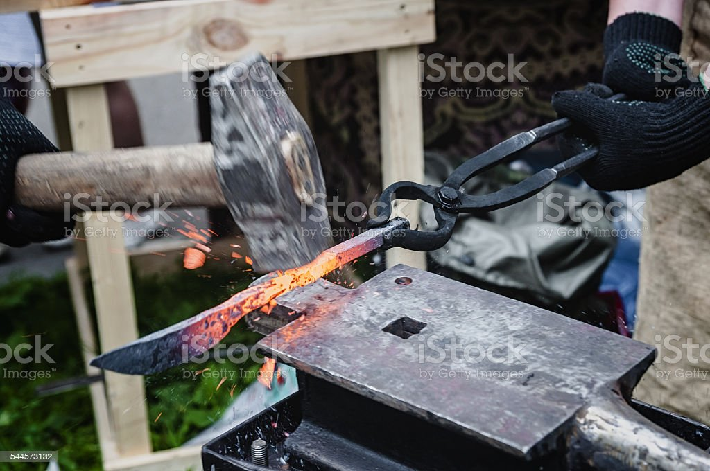 Forging of metal products on the anvil stock photo