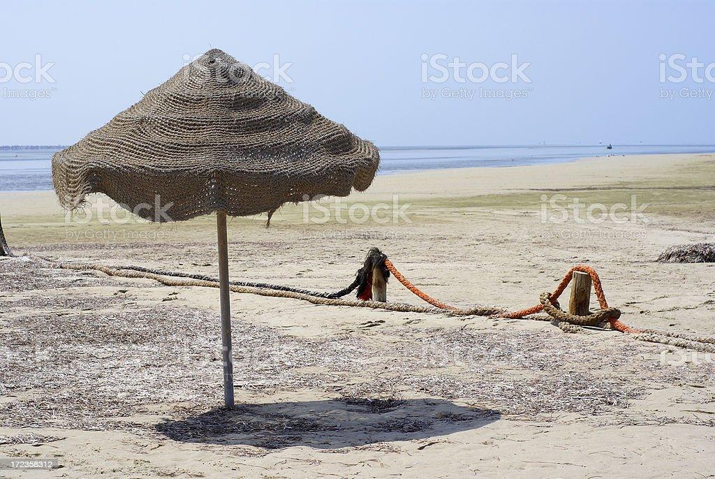 Forgotten umbrella on beach. royalty-free stock photo