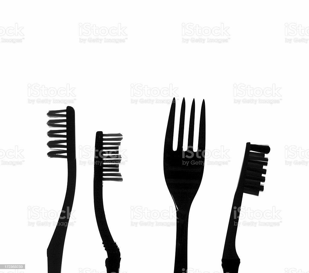 Fork among toothbrushes royalty-free stock photo