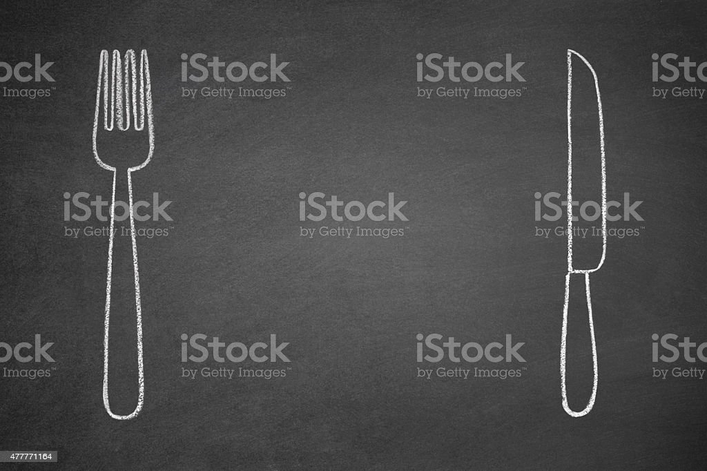 Fork and Knife on Blackboard stock photo
